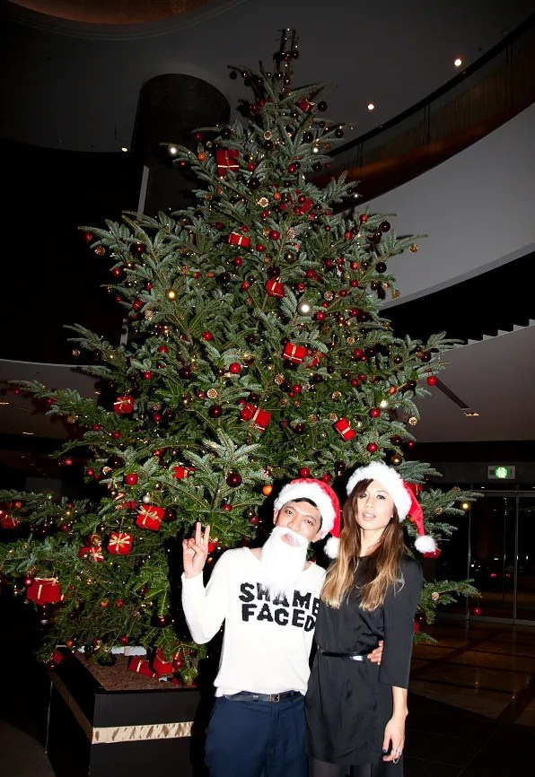 Bryanboy and Rumi Neely in front of a Christmas Tree at the Cerulean Tower hotel, Tokyo Japan