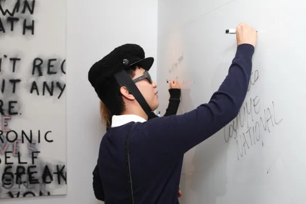 Bryanboy and Rumi Neely signing the Costume National wall