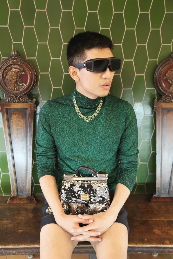 Bryanboy wearing a Prada lurex turtleneck and Dolce & Gabbana Mini Miss Sicily Sequined Bag