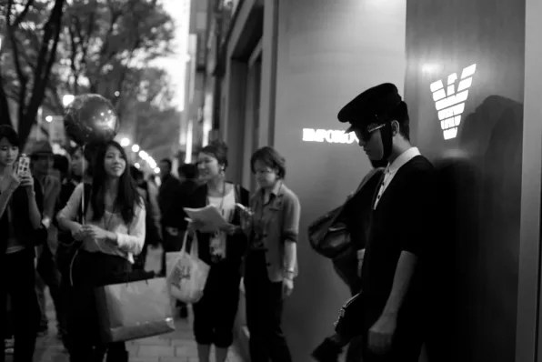 Bryanboy posing for Japanese fans at Emporio Armani during Fashion's Night Out 2011 Tokyo
