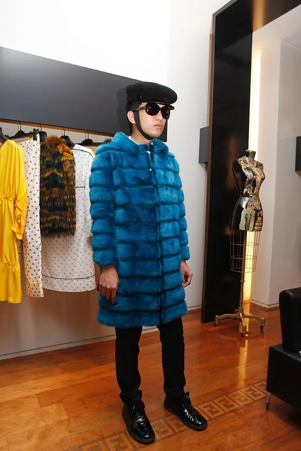 Bryanboy wearing a Fendi mink fur coat