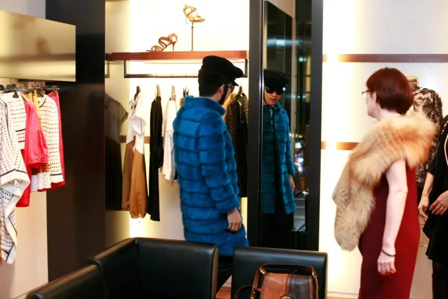 Bryanboy trying on a mink coat with Fendi Japan Ceo
