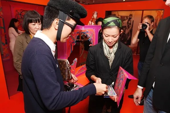 Bryanboy playing with paper Hermes bracelets
