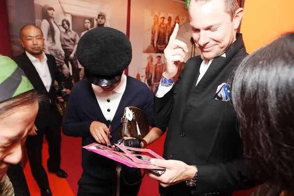 Bryanboy and his agent from CAA looking at photos inside the Hermes pop-up store