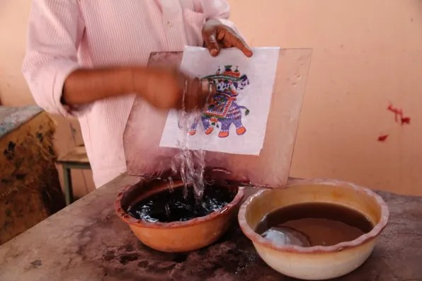 A Jaipur craftsman showing chemicals used in the block printing process