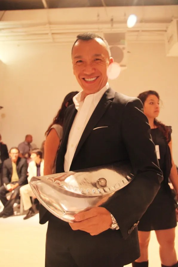 Joe Zee carrying a Margiela clutch bag
