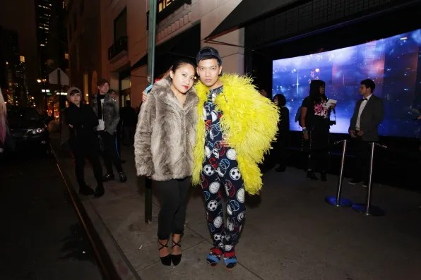 Wendy Lam and Bryanboy outside Barney's New York for Lady Gaga's Workshop Opening