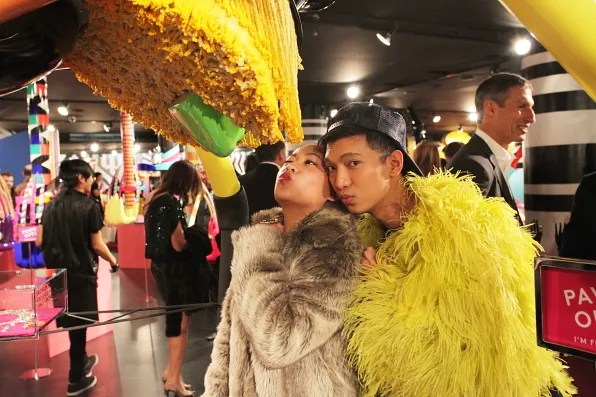 Wendy Lam kissing Lady Gaga Spider and Bryanboy looking into the camera