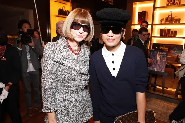Anna Wintour smiling with Bryanboy at Louis Vuitton Omotesando store in Tokyo