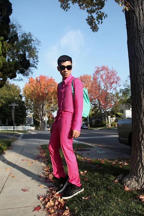 Bryanboy in a pink shirt and pink trousers by Versace x H&M