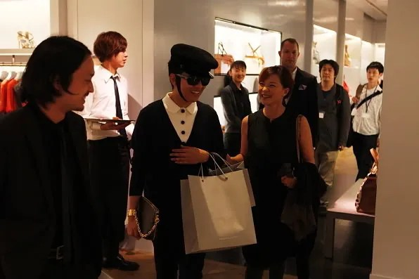Bryanboy and his agent leaving the Reed Krakoff store