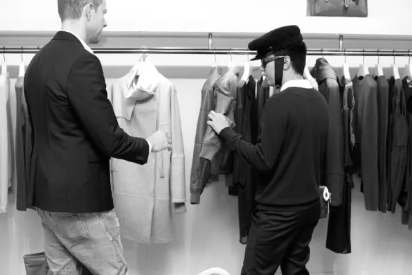 Bryanboy and CAA agent looking at Reed Krakoff jackets