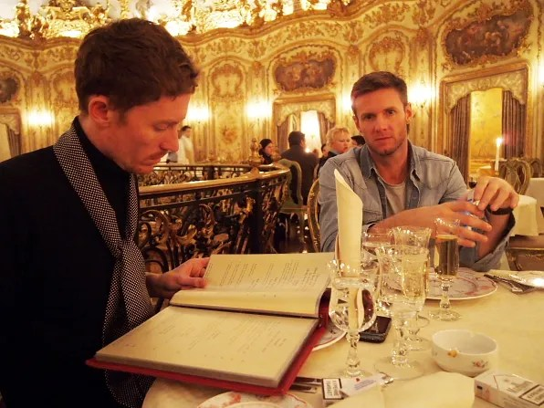 Patrick and Keith browsing the menu at Turandot restaurant, Moscow Russia