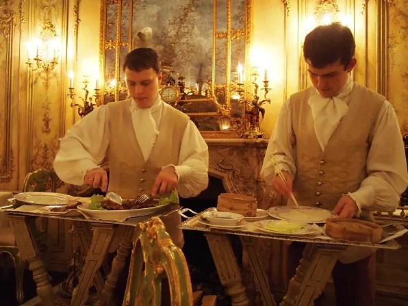 Waiters preparing Bryanboy's crispy aromatic roast duck meal