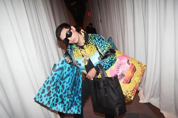 Bryanboy carrying Versace for H&M paper bags
