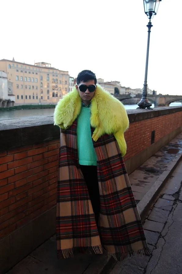 Bryanboy wearing a yellow fox fur and plaid cashmere scarf by Sonia Rykiel in Florence
