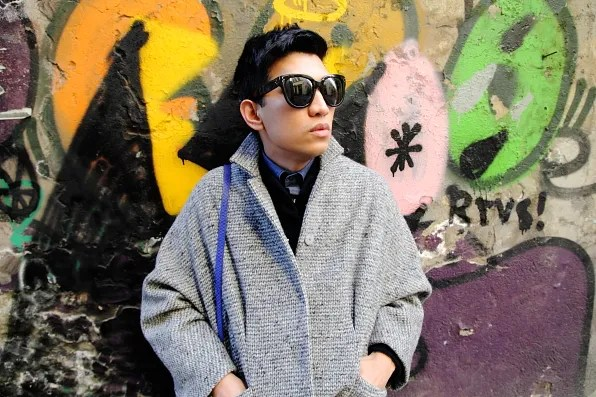 Bryanboy wearing a gray coat from Cachentta NYC