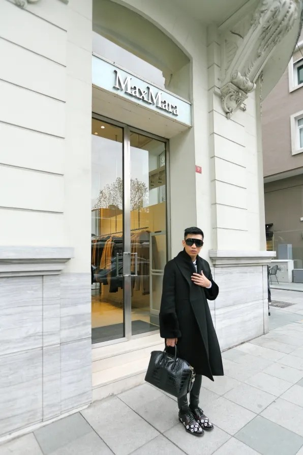 Bryanboy wearing a Max Mara coat outside the Max Mara store in Istanbul, Turkey