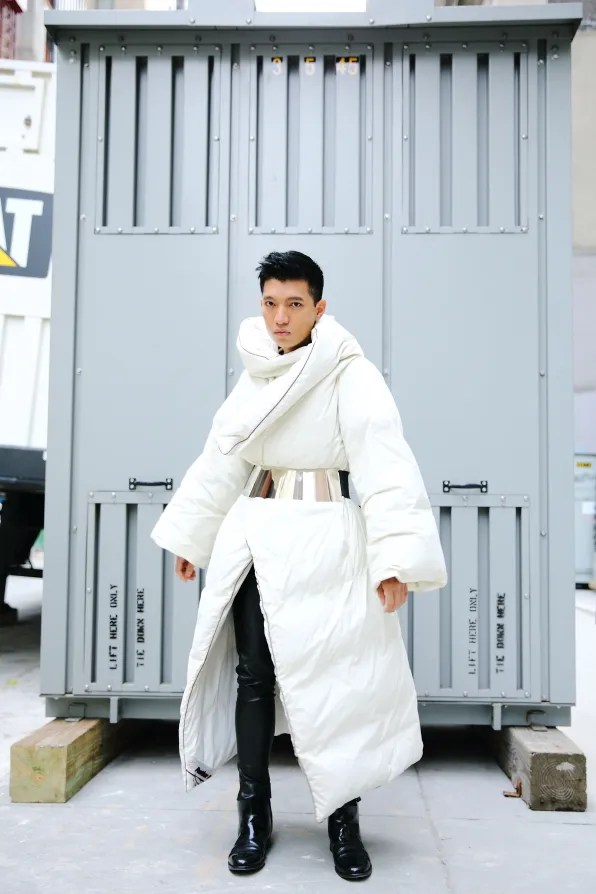 Bryanboy wearing a Maison Martin Margiela x H&M collaboraton duvet coat