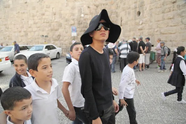 Bryanboy walking with kids in Jerusalem