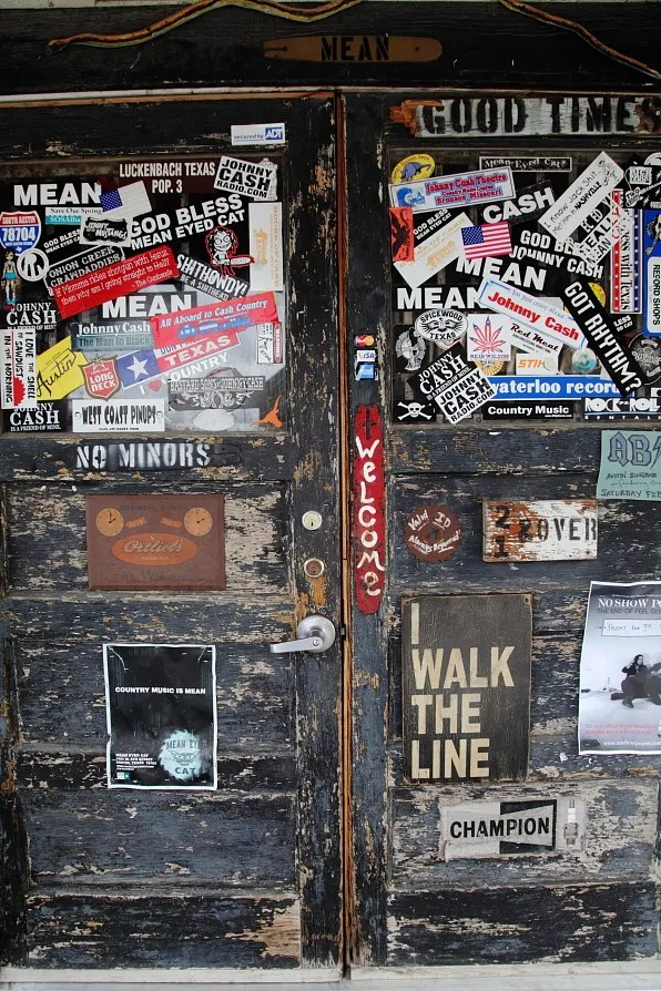 Door with stickers at Mean Eyed Cat Austin Texas