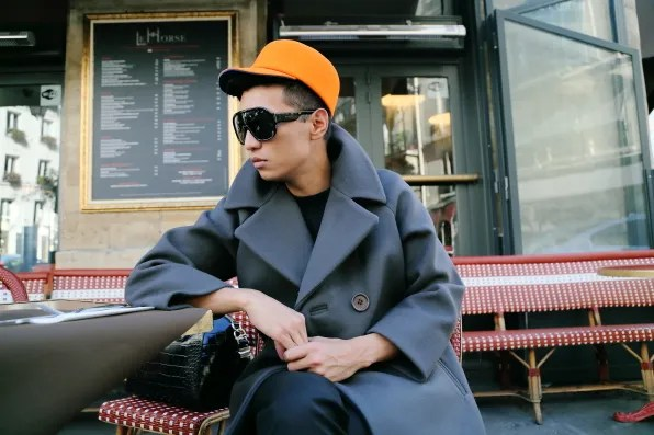 Bryanboy at Saint Germain wearing a Kenzo hat and Sonia Rykiel coat