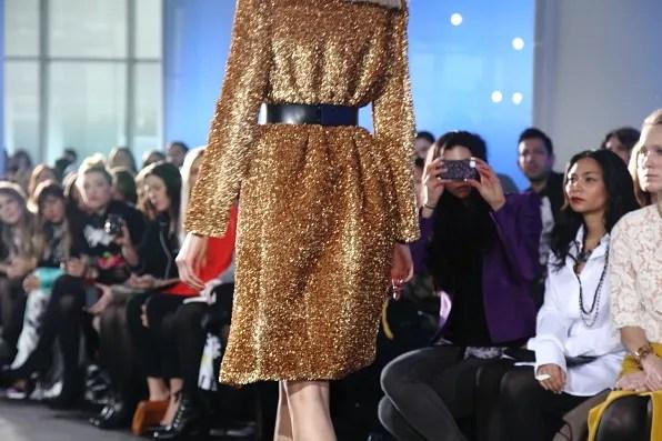 magdalena frackowiak wearing a gold coat from prabal gurung fall winter 2012