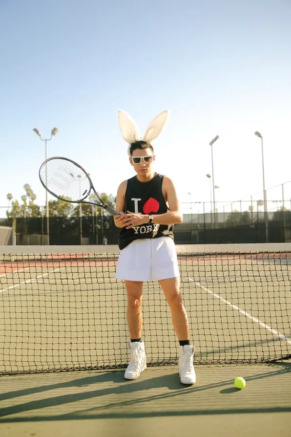 Bryanboy in West Hollywood playing tennis wearing 3.1 Phillip Lim I Love Nueva York tank top