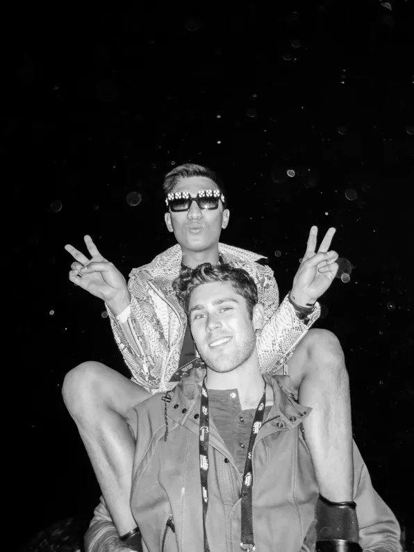 Bryanboy sitting on top of Queenie at Rihanna concert