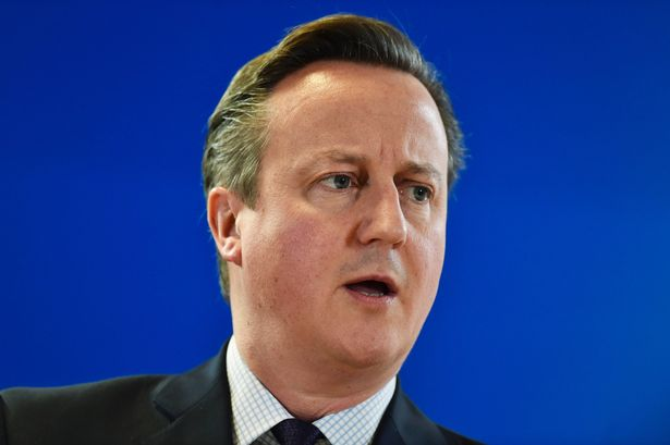 British Prime Minister David Cameron holds a press conference, as part of an extraordinary council at the European Union headquarters in Brussels on December 18, 2015