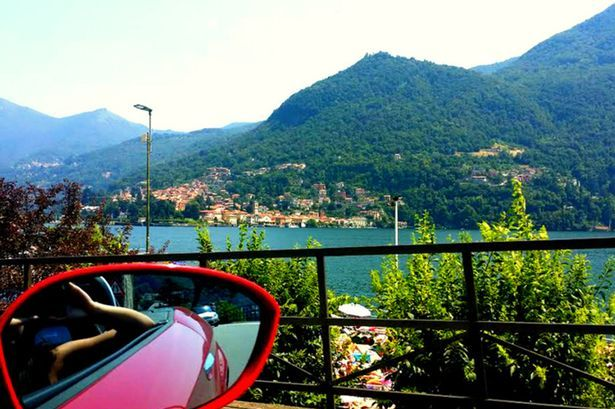 Monica Lynn as she travel around the world for free. Driving around Lake Como