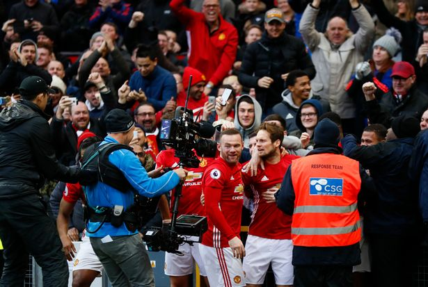 Juan Mata celebrates with teammates and the fans after scoring