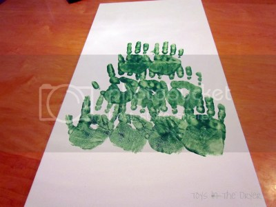 make a Christmas tree out of hand prints