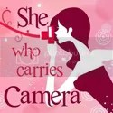 She Who Carries Camera