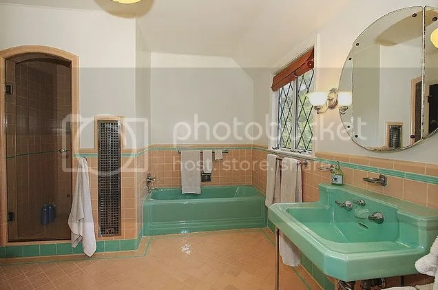 sea foam green original tile bathroom with green fixtures from the 1940s it has streamlined details that were so popular in the late 30s to mid 1940