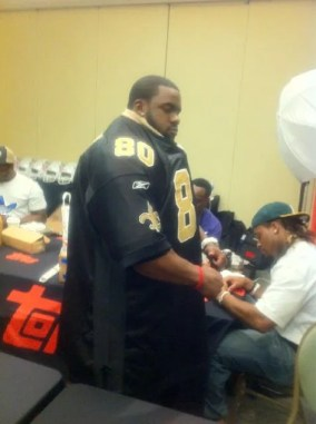 Topps Rookie Premiere Photo Shoot Mark Ingram Trying on Jerseys