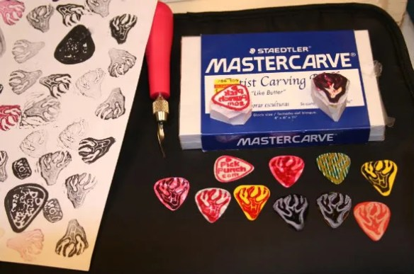 Hand,stamp,make your own,guitar pick,do it yourself,rubber stamp,pick punch