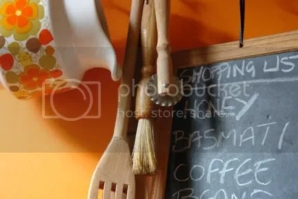photo of a child's writing slate and wooden kitchen utensils