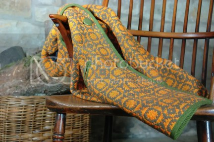 Vintage orange & green Welsh wool coat on stick back chair