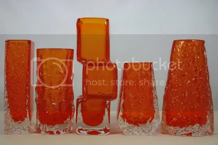 Group of tangerine Whitefriars glass vases designed by Geoffrey Baxter