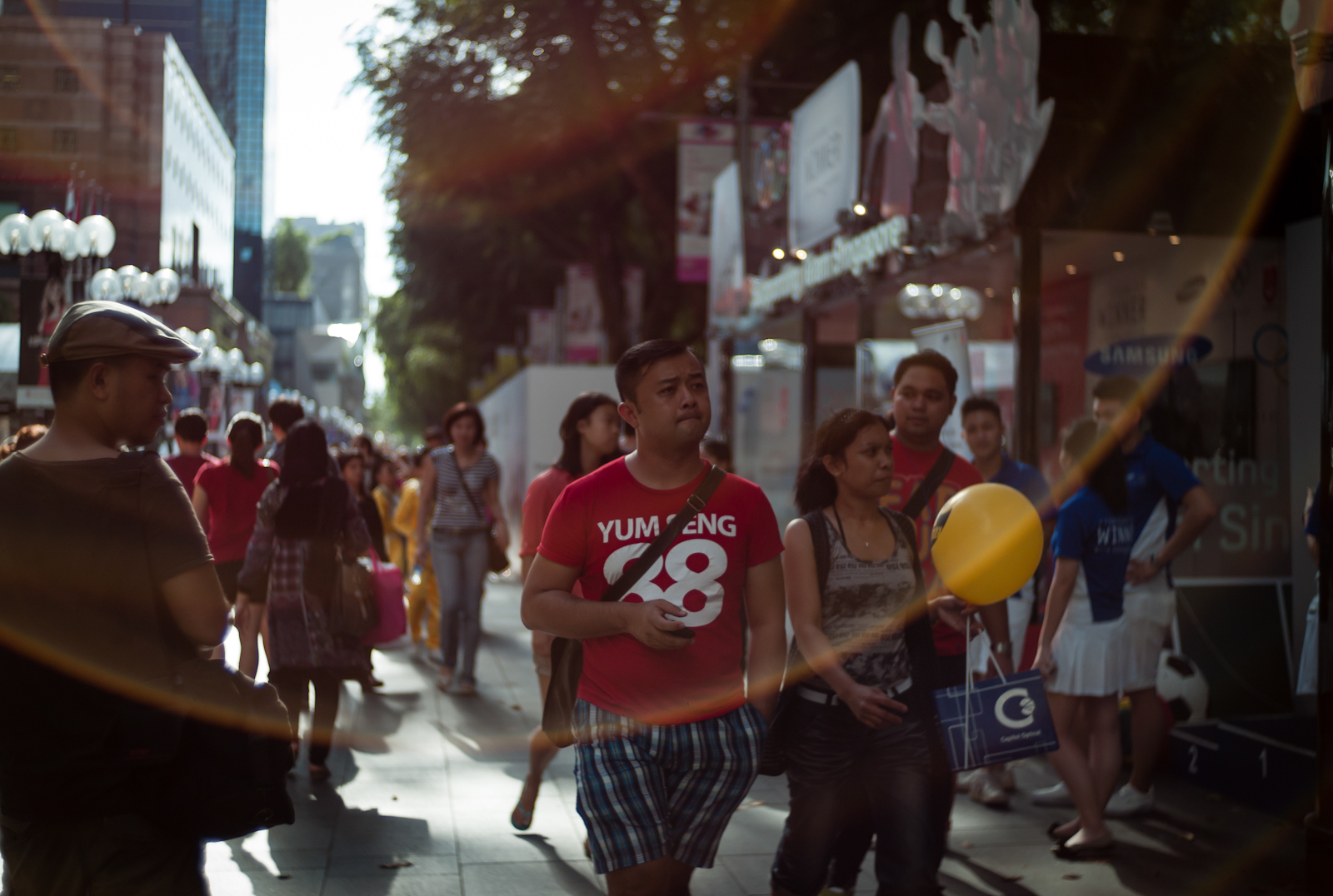 Street scene in Orchard Road with a large lens flare