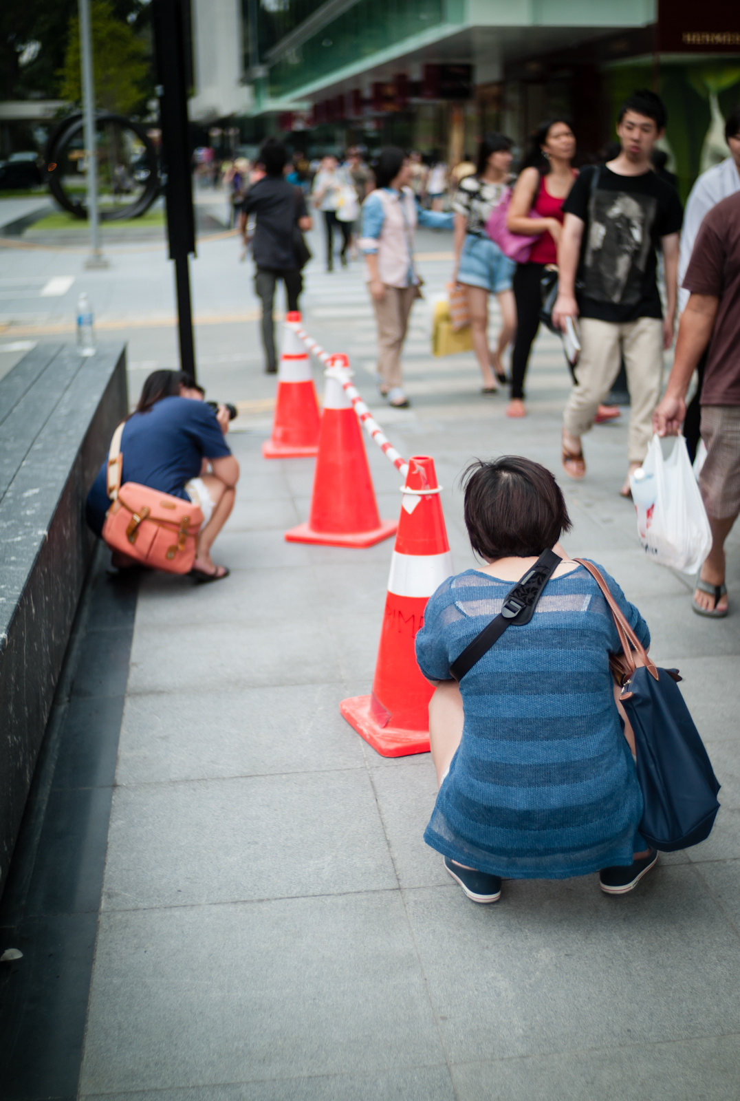Two photographers shooting cones in Orchard Road