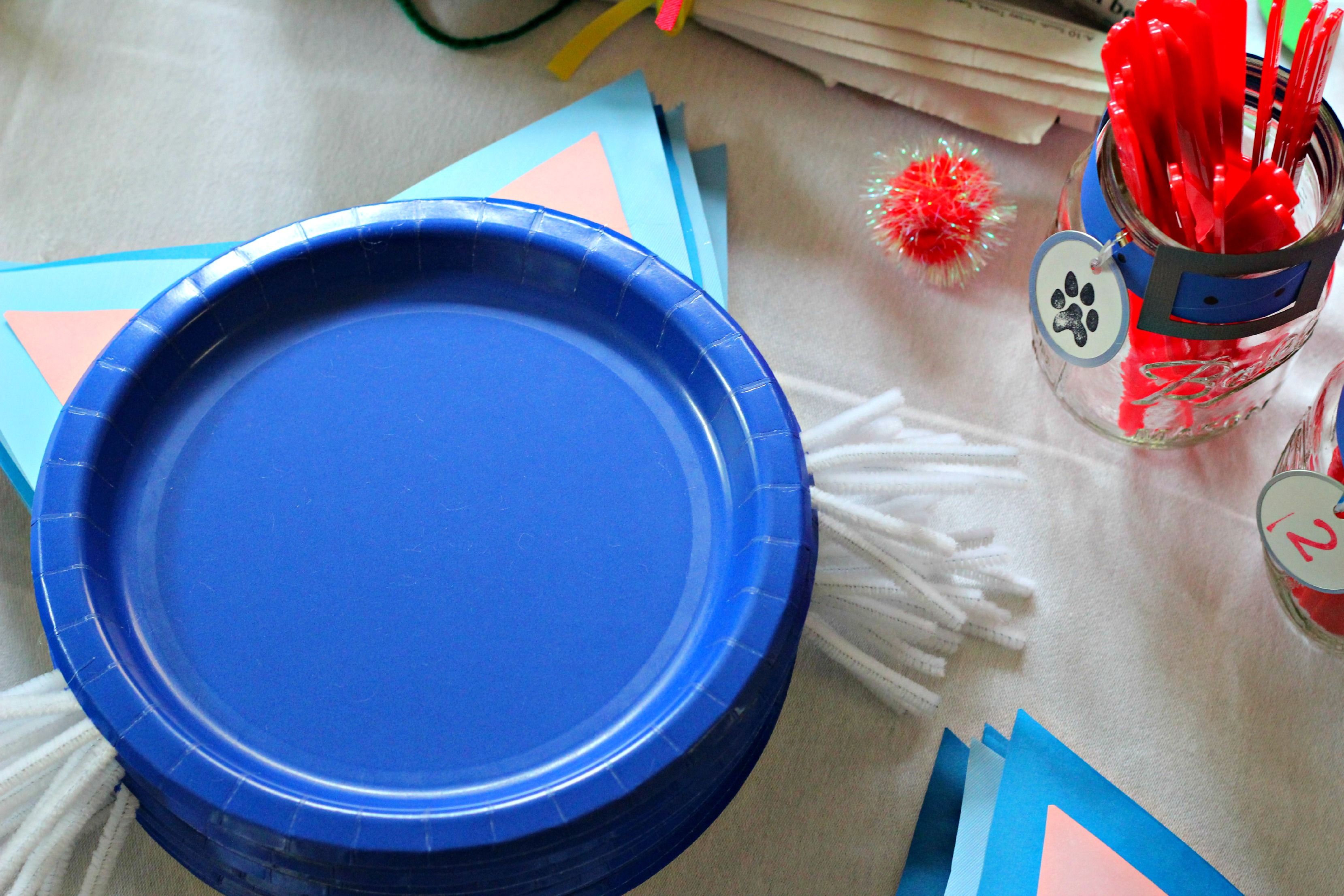 The blue paper plates were decorated as cats with ears and whiskers. The dessert plates were decorated as puppies with black ears and a fuzzy nose. & Puppy and Kitten Second Birthday Party - Ice Cream Off Paper Plates
