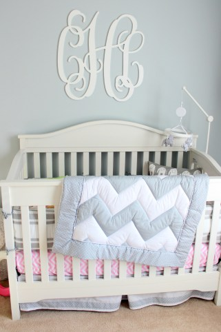 gray and pink nursery crib