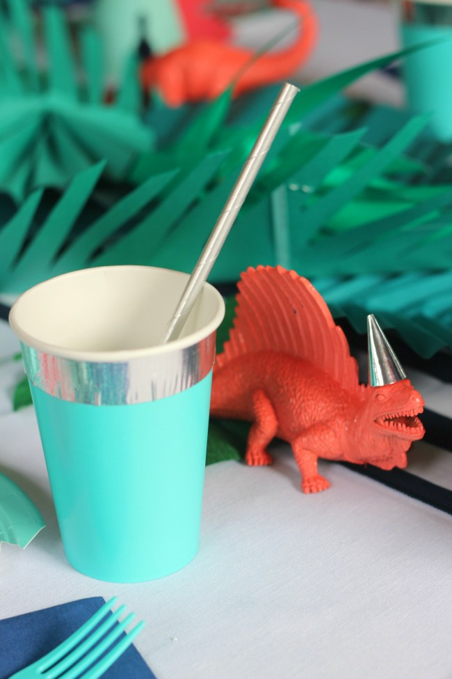 cup and dinosaur