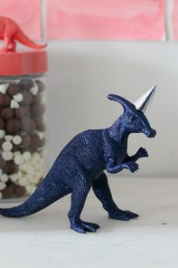 dinosaur figure with party hat
