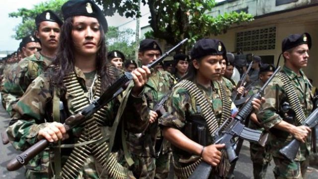 Guerrillas of the Marxist Revolutionary Armed Forces of Colombia (FARC) march in a military parade 07 February 2001 in San Vicente.