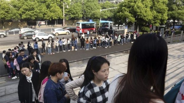 Supporters line up to attend a court session where a gay couple is expected to argue in China's first gay marriage case in Changsha in central China's Hunan province on Wednesday, April 13, 2016.