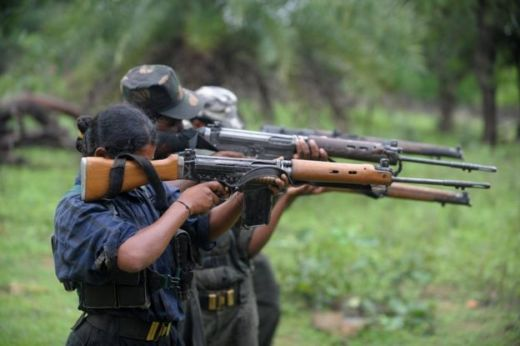 Indian Maoists ready their weapons as they take part in a training camp in a forested area of Bijapur District in the central Indian state of Chhattisgarh on July 8, 2012