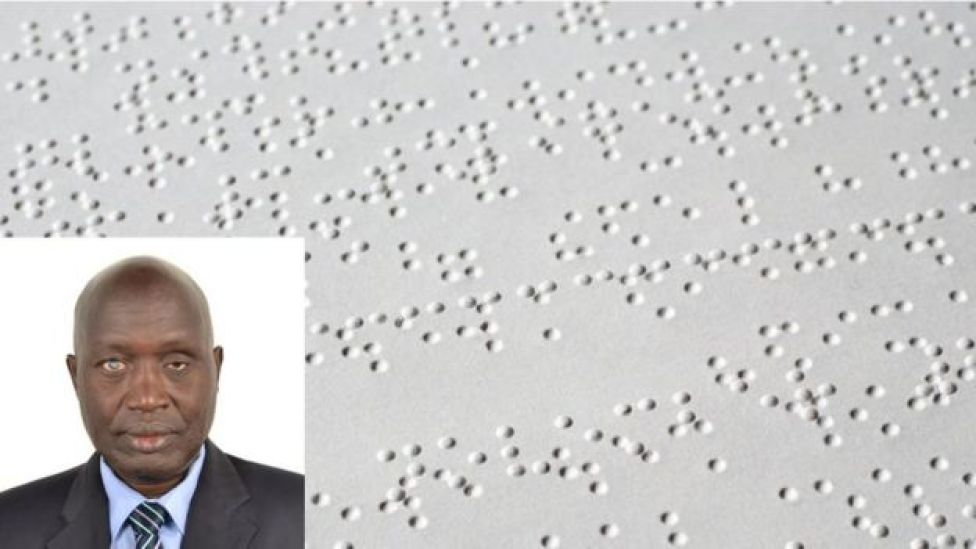 Victor Locoro with a Braille document in the background